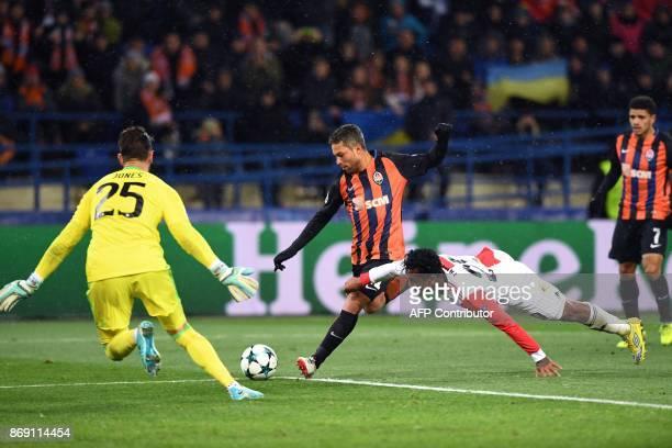 Shakhtar's Ukrainian midfielder Marlos shoots and scores a goal past Feyenoord's Australian goalkeeper Brad jones during the UEFA Champions League...