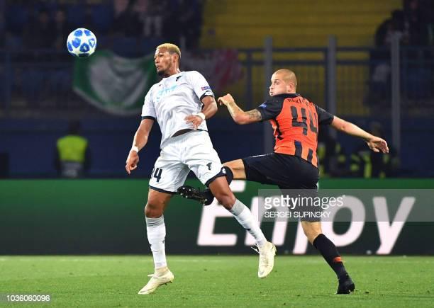 Shakhtar's Yaroslav Rakitskiy vies with Hoffenheim's Cassio Joelinton during the UEFA Champions League Group F football match between FC Shakhtar...