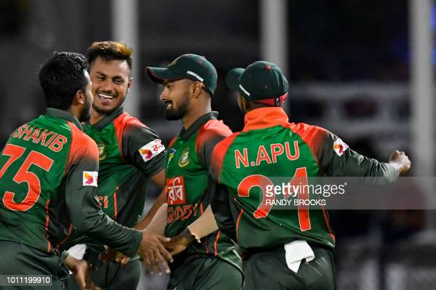 Shakib Al Hasan Abu Hider Liton Das and Nazmul Islam of Bangladesh celebrates the dismissal of Marlon Samuels of West Indies during the 2nd T20i...