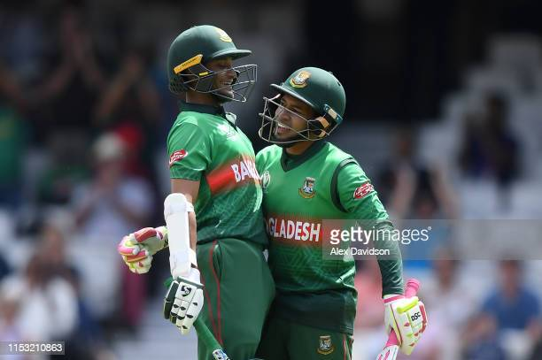 Shakib Al Hasan and Mushfiqur Rahim of Bangladesh embrace during the Group Stage match of the ICC Cricket World Cup 2019 between South Africa and...