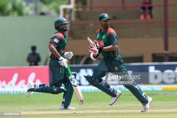 Shakib Al Hasan and Tamim Iqbal of Bangladesh 100 partnership run during the 1st ODI match between West Indies and Bangladesh at Guyana National...