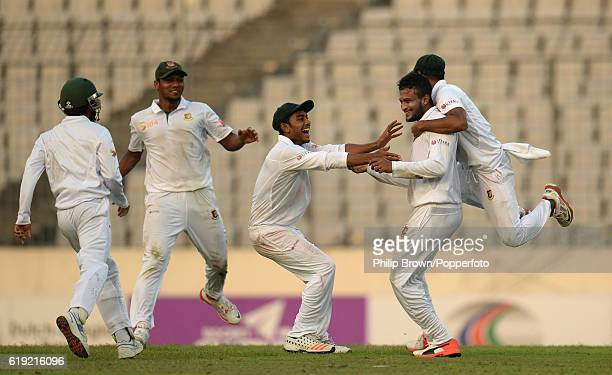 Shakib Al Hasan is pounced on after dismissing Zafar Ansari during the third day of the second test match between Bangladesh and England at Shere...