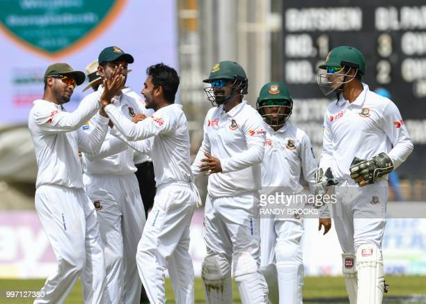 Shakib Al Hasan Mehidy Hasan Miraz Liton Das Mominul Haque and Nurul Hasan of Bangladesh celebrate the dismissal of Devon Smith of West Indies during...
