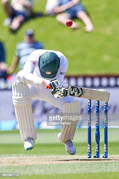 Shakib Al Hasan of Bangladesh avoids a bouncer during day two of the First Test match between New Zealand and Bangladesh at Basin Reserve on January...