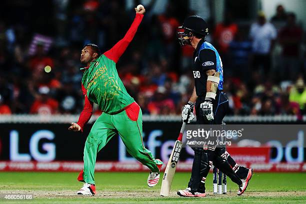 Shakib Al Hasan of Bangladesh bowls during the 2015 ICC Cricket World Cup match between Bangladesh and New Zealand at Seddon Park on March 13 2015 in...