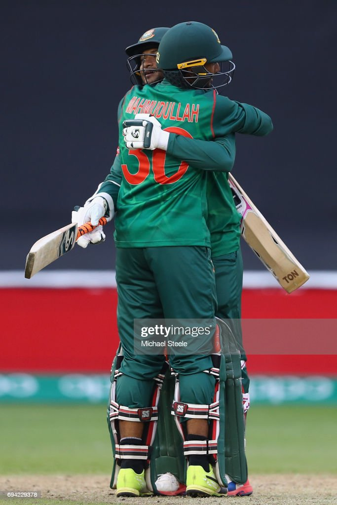 Shakib Al Hasan of Bangladesh celbrates with Mahmudullah after reaching his century during the ICC Champions Trophy match between New Zealand and Bangladesh at the SWALEC Stadium on June 9, 2017 in Cardiff, Wales.