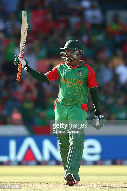 Shakib Al Hasan of Bangladesh celebrates after reaching his half century during the 2015 ICC Cricket World Cup match between Bangladesh and...
