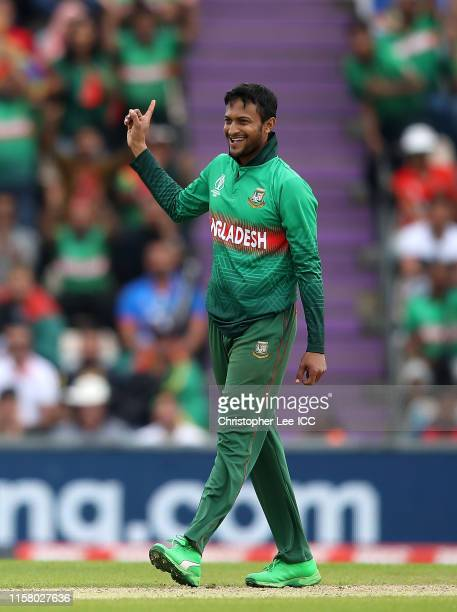 Shakib Al Hasan of Bangladesh celebrates after taking the wicket of Najibullah Zadran of Afghanistan during the Group Stage match of the ICC Cricket...