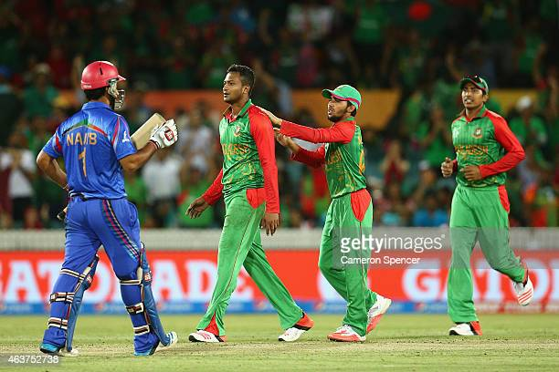 Shakib Al Hasan of Bangladesh celebrates dismissing Najibullah Zadran of Afghanistan for lbw during the 2015 ICC Cricket World Cup match between...