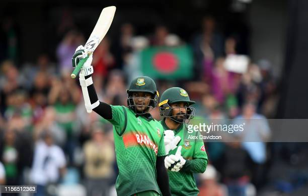 Shakib Al Hasan of Bangladesh celebrates his century with Liton Das of Bangladesh during the Group Stage match of the ICC Cricket World Cup 2019...
