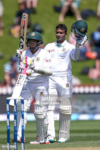 Shakib Al Hasan of Bangladesh celebrates his century with teammate Mushfiqur Rahim during day two of the First Test match between New Zealand and...