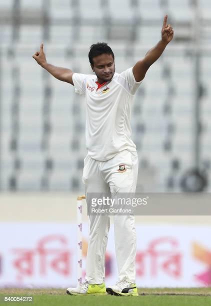 Shakib Al Hasan of Bangladesh celebrates taking the wicket of Matthew Renshaw of Australia during day two of the First Test match between Bangladesh...