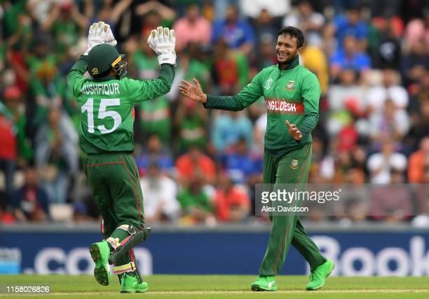 Shakib Al Hasan of Bangladesh celebrates taking the wicket of Najibullah Zadran of Afghanistan with Mushfiqur Rahim of Bangladesh during the Group...