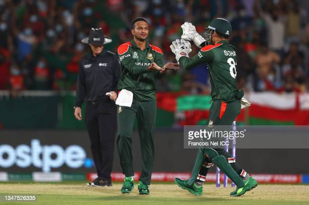 Shakib Al Hasan of Bangladesh celebrates the wicket of Jatinder Singh of Oman with team mate Nurul Hasan during the ICC Men's T20 World Cup match...