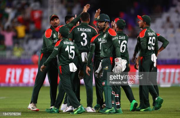 Shakib Al Hasan of Bangladesh celebrates the wicket of Michael Leask of Scotland during the ICC Men's T20 World Cup match between Bangladesh and...