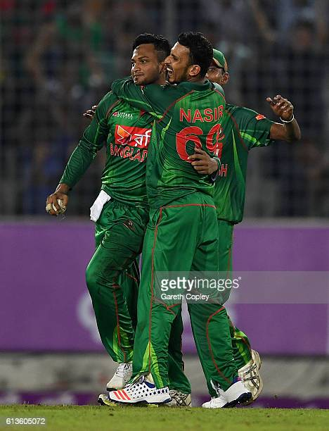 Shakib Al Hasan of Bangladesh celebrates with Nasir Hossain after catching out Moeen Ali of England during the 2nd One Day International match...