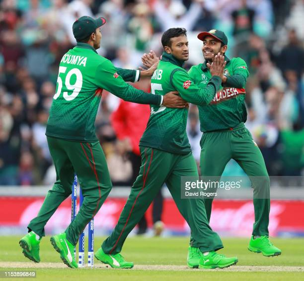 Shakib Al Hasan of Bangladesh celebrates with team mates after taking the wicket of Martin Guptill during the Group Stage match of the ICC Cricket...