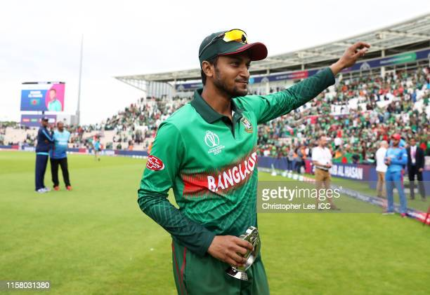 Shakib Al Hasan of Bangladesh holds the Man of the Match award as he waves to the crowd during the Group Stage match of the ICC Cricket World Cup...