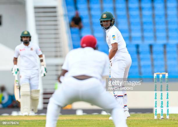 Shakib Al Hasan of Bangladesh is caught by Jason Holder of West Indies during day 1 of the 1st Test between West Indies and Bangladesh at Sir Vivian...