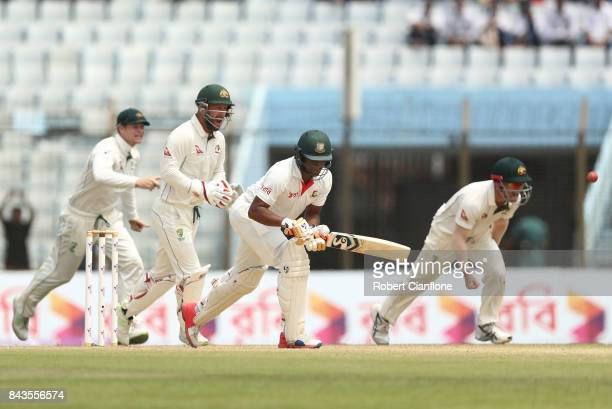 Shakib Al Hasan of Bangladesh is caught out by David Warner of Australia during day four of the Second Test match between Bangladesh and Australia at...