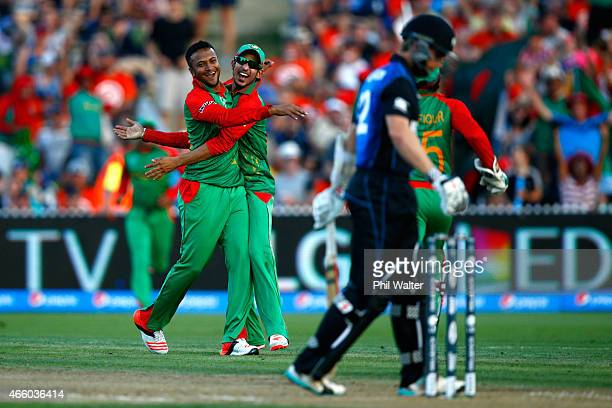 Shakib Al Hasan of Bangladesh is hugged by Nasir Hossain as he celebrates his wicket of Kane Williamson of New Zealand during the 2015 ICC Cricket...