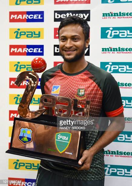 Shakib Al Hasan of Bangladesh poses with the winning trophy after Bangladesh won the 3rd and final T20i match against West Indies at Central Broward...