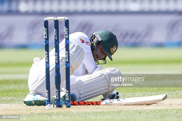 Shakib Al Hasan of Bangladesh recovers after being struck by the ball during day two of the First Test match between New Zealand and Bangladesh at...