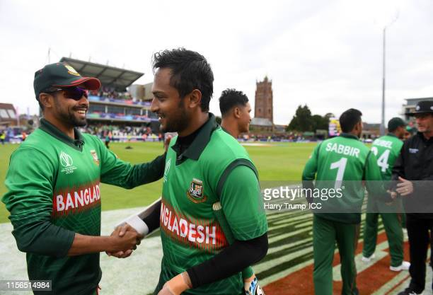 Shakib Al Hasan of Bangladesh shakes hands with his Bangladesh team mates after scoring an unbeaten 124 during the Group Stage match of the ICC...