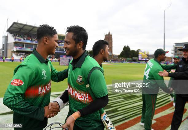 Shakib Al Hasan of Bangladesh shakes hands with Mohammad Saifuddin of Bangladesh after scoring an unbeaten 124 during the Group Stage match of the...