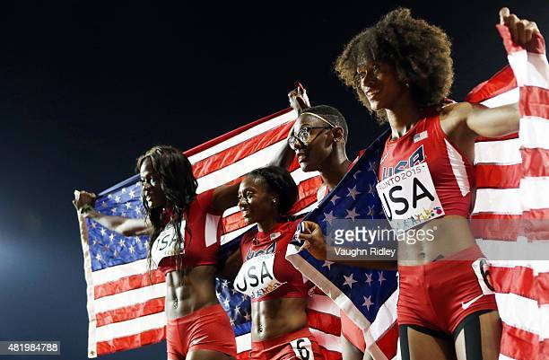Shakima Wimbley, Kyra Jefferson, Shamier Little and Kendall Baisden of the USA celebrate winning Gold in the Women's 4x400m Final during Day 15 of...