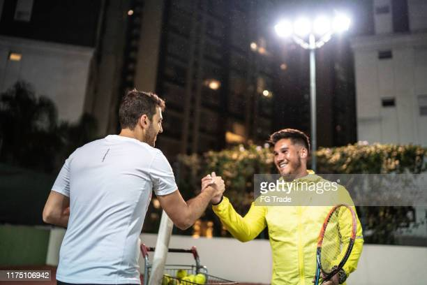 shaking hands after a friendly game after tennis classes training - showing respect stock pictures, royalty-free photos & images
