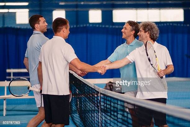 shaking hands after tennis match - doubles stock photos and pictures