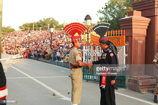 Shaking hands at Wagah border closing 'lowering of the flags' ceremony, which is a daily military practice that the security forces of India and...