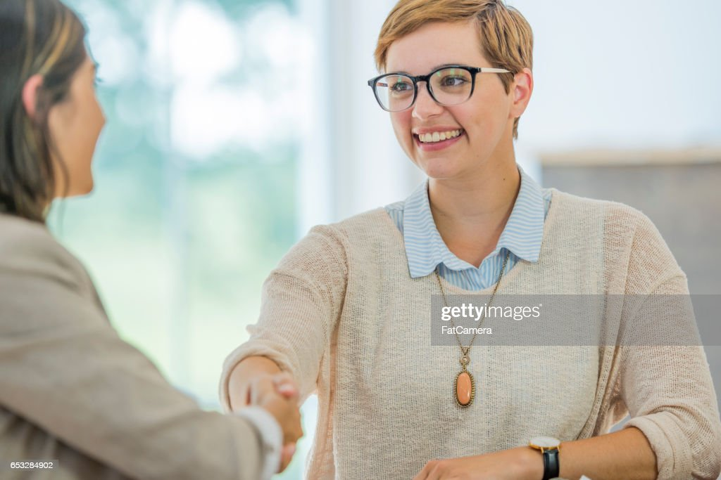 Shaking Hands Before an Interview : Stock Photo
