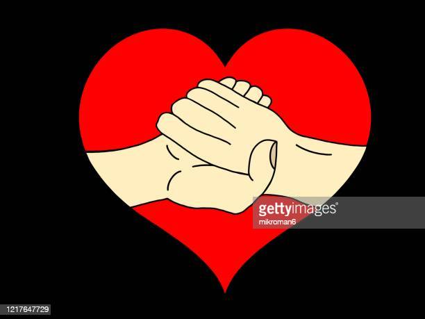 shaking hands in red heart shape - handshake stock pictures, royalty-free photos & images