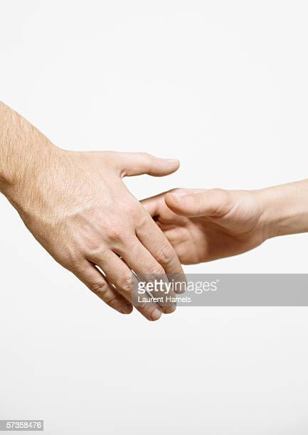 shaking hands - hand shaking hands stock pictures, royalty-free photos & images