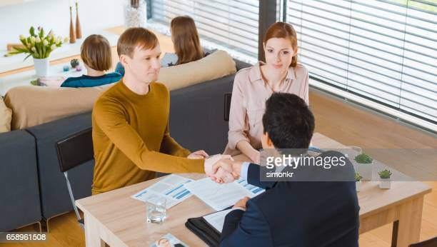 shaking hands - looking down her blouse stock photos and pictures