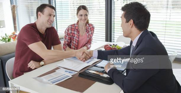 shaking hands - fully unbuttoned stock pictures, royalty-free photos & images