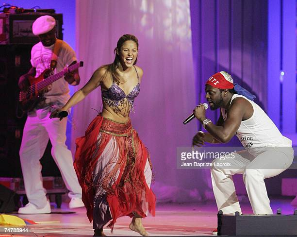 Shakira and Wyclef Jean perform My Hips Don't Lie at the Seminole Hard Rock Hotel and Casino in Hollywood Florida