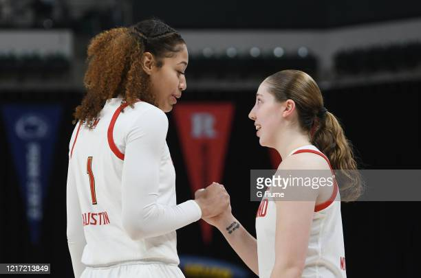 Shakira Austin of the Maryland Terrapins celebrates with Taylor Mikesell during the game against the Ohio State Buckeyes during the Championship game...