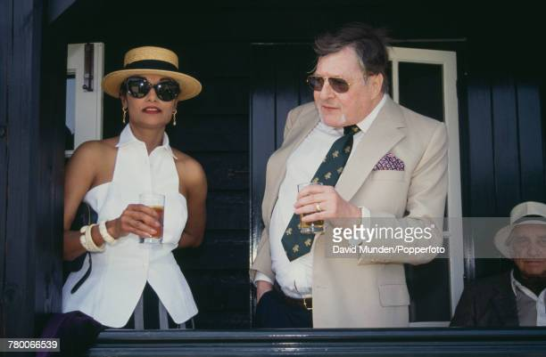 Shakira Caine and Americanborn British philanthropist Sir Paul Getty at the first match to be played at Getty's new cricket ground on his Wormsley...