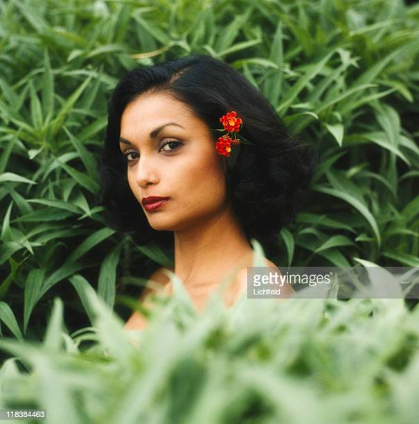 Shakira Caine, Guyana born model and actress, clothes and costume jewellery designer in the garden at home in Beverley Hills, USA , 8th October 1980.