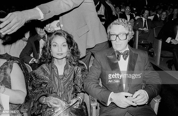 Shakira Caine with her husband Michael seated at at theater; circa 1970; New York