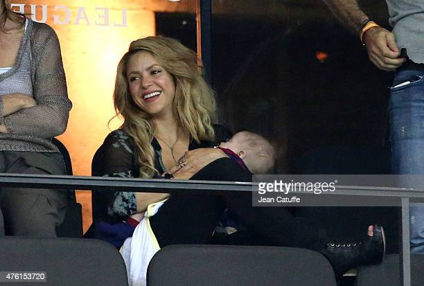 Shakira holds her younger son Sasha Pique Mebarak while husband Gerard Pique and her older son Milan Pique Mebarak celebrate the victory on the field...