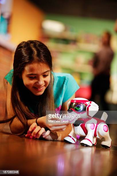 Shakira RiddellMorales plays with a Teksta robotic puppy at a media event at St Mary's Church in Marylebone on November 6 2013 in London England The...