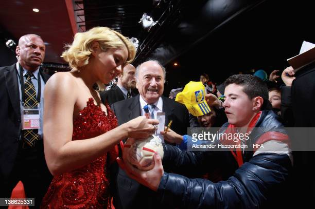 Shakira signs autographs for fans in the Fanzone after arriving with FIFA president Joseph SBlatter on the red carpet prior to the FIFA Ballon d'Or...
