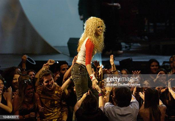 Shakira stands up to accept an award at the MTV Video Music Awards Latinoamerica 2002