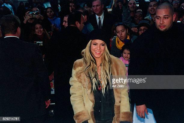 Shakira wearing a shearling coat with her bodyguard circa 1990 New York