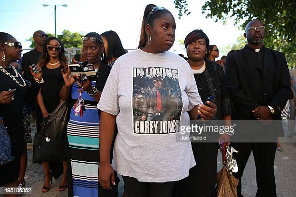 Shakra Waters wears a shirt that reads 'In loving memory of Corey Jones' as she waits for the start of the funeral for Corey Jones at the Payne...