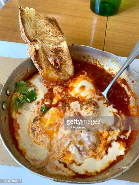 shakshuka in a restaurant - flat leaf parsley stock pictures, royalty-free photos & images
